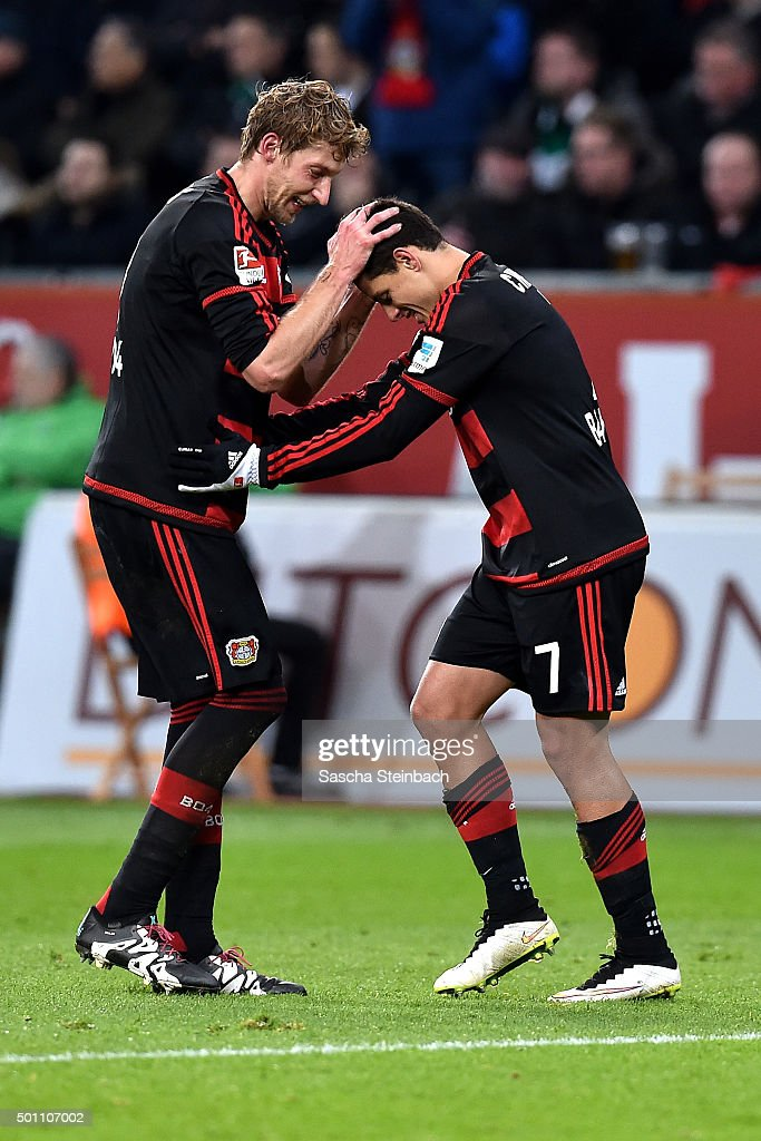 Stefan Kiessling and Chicharito of Leverkusen celebrate after scoring their team's second goal during the Bundesliga match between Bayer Leverkusen...