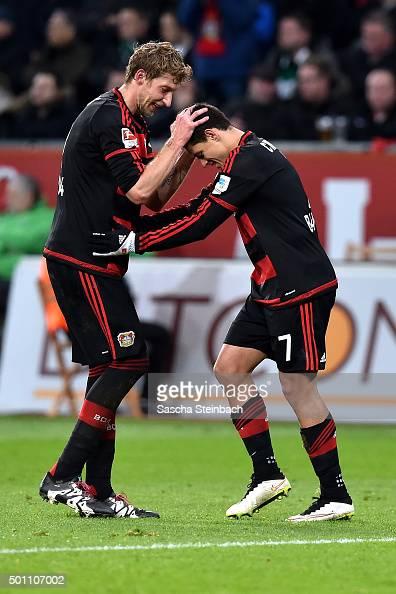 Stefan Kiessling and Chicharito of Leverkusen celebrate after scoring their team's second goal during the Bundesliga match between Bayer Leverkusen...