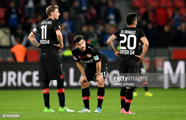 Stefan Kiessling Kevin Volland and Charles Aranguiz of Leverkusen look dejected after the Bundesliga match between Bayer 04 Leverkusen and FC Schalke...