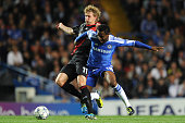 Stefan Kiessling of Bayer Leverkusen and Jon Obi Mikel of Chelsea battle for the ball during the UEFA Champions League Group E match between Chelsea...