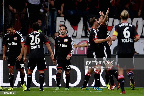 Stefan Kiessling of Bayer Leverkusen celebrates with teammates after scoring his team's third goal during the Bundesliga match between Bayer 04...