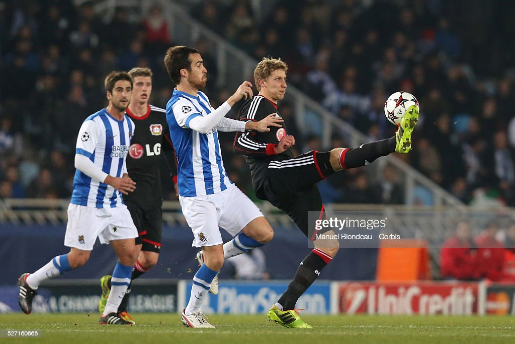 Stefan Kiessling of Bayer Leverkusen duels for the ball with Mikel Gonzalez of Real Sociedad during the UEFA Champions league football match between...