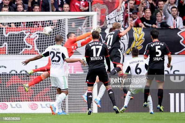 Stefan Kiessling of Bayer Leverkusen heads his team's second goal during the Bundesliga match between Bayer 04 Leverkusen and VfL Wolfsburg at...