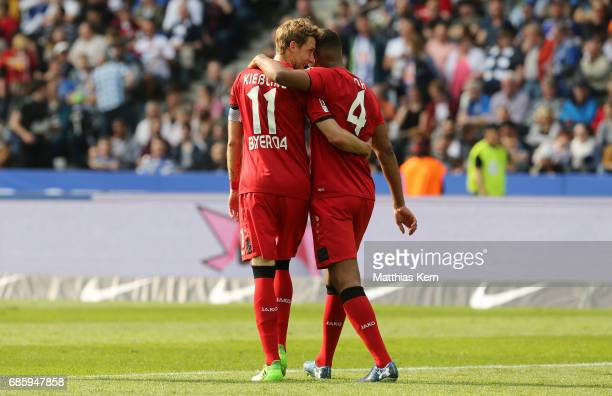 Stefan Kiessling of Leverkusen and Jonathan Tah look on during the Bundesliga match between Hertha BSC and Bayer 04 Leverkusen at Olympiastadion on...