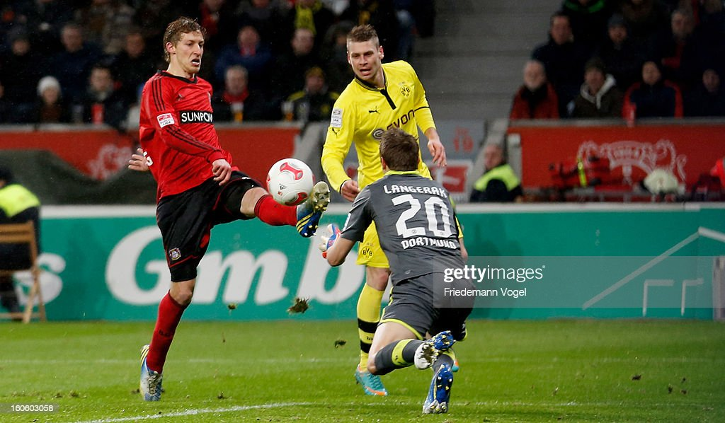 Stefan Kiessling (L) of Leverkusen and Mitchell Langerak (R) of Dortmund battle for the ball during the Bundesliga match between Bayer 04 Leverkusen and Borussia Dortmund at BayArena on February 3, 2013 in Leverkusen, Germany.