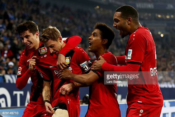 Stefan Kiessling of Leverkusen celebrate with his team mates after he scores the opening goal during the Bundesliga match between FC Schalke 04 and...