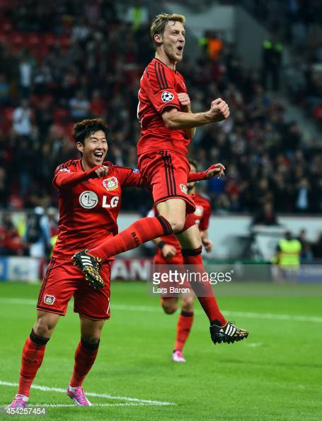 Stefan Kiessling of Leverkusen celebrates after scoring his teams third goal during the UEFA Champions League Qualifying PlayOffs Round second leg...