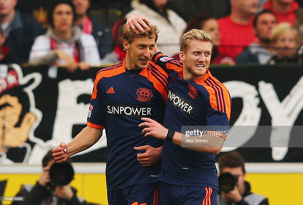 <a gi-track='captionPersonalityLinkClicked' href=/galleries/search?phrase=Stefan+Kiessling&family=editorial&specificpeople=605405 ng-click='$event.stopPropagation()'>Stefan Kiessling</a> (L) of Leverkusen celebrates his team's first goal with team mate <a gi-track='captionPersonalityLinkClicked' href=/galleries/search?phrase=Andre+Schuerrle&family=editorial&specificpeople=5513825 ng-click='$event.stopPropagation()'>Andre Schuerrle</a> during the Bundesliga match between VfB Stuttgart and Bayer 04 Leverkusen at Mercedes-Benz Arena on October 7, 2012 in Stuttgart, Germany.