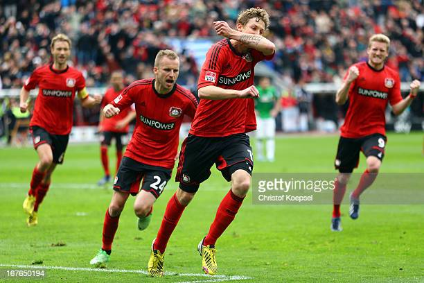 Stefan Kiessling of Leverkusen celebrates the first goal with Simon Rolfes Michal Kadlec and Andre Schuerrle during the Bundesliga match between...