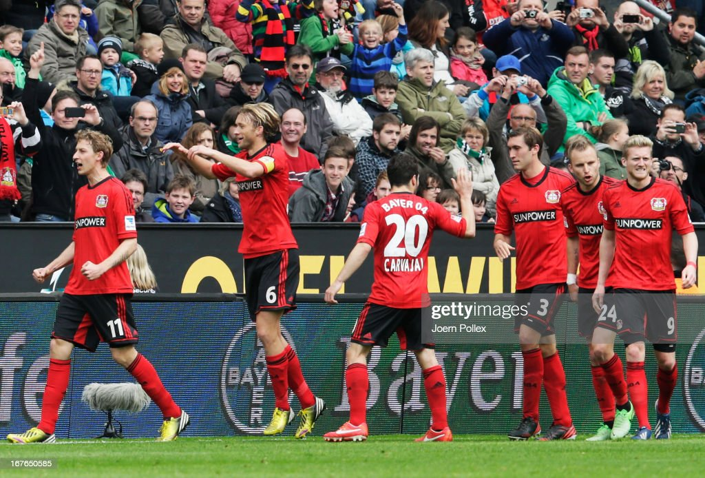 <a gi-track='captionPersonalityLinkClicked' href=/galleries/search?phrase=Stefan+Kiessling&family=editorial&specificpeople=605405 ng-click='$event.stopPropagation()'>Stefan Kiessling</a> (L) of Leverkusen celebrates with his team mates after scoring his team's first goal during the Bundesliga match between Bayer 04 Leverkusen at SV Werder Bremen at BayArena on April 27, 2013 in Leverkusen, Germany.