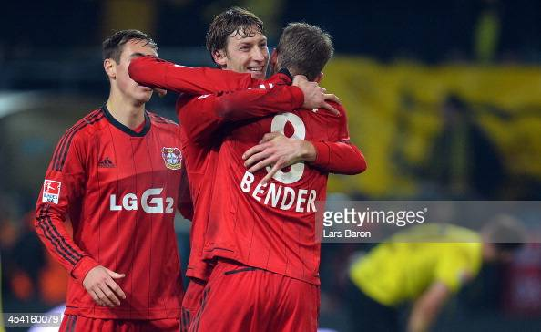 Stefan Kiessling of Leverkusen celebrates with Lars Bender after winning the Bundesliga match between Borussia Dortmund and Bayer Leverkusen at...