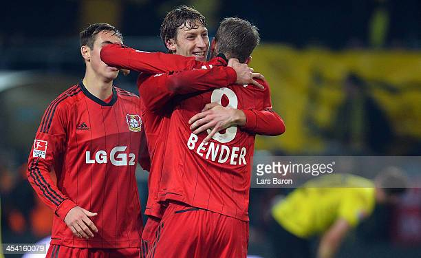Stefan Kiessling of Leverkusen celebrates with Lars Bender after winning the Bundesliga match between Borussia Dortmund and Bayer Leverkusen at...