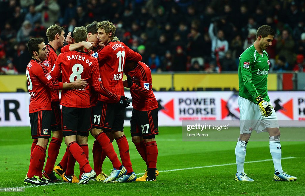 <a gi-track='captionPersonalityLinkClicked' href=/galleries/search?phrase=Stefan+Kiessling&family=editorial&specificpeople=605405 ng-click='$event.stopPropagation()'>Stefan Kiessling</a> of Leverkusen celebrates with team mates after scoring his teams second goal during the Bundesliga match between Bayer 04 Leverkusen and Eintracht Frankfurt at BayArena on January 19, 2013 in Leverkusen, Germany.