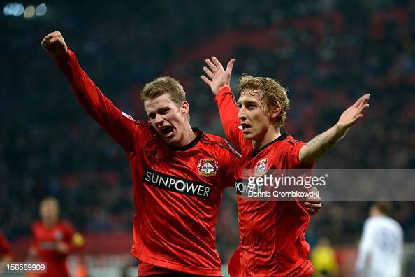 Stefan Kiessling of Leverkusen celebrates with teammate Lars Bender after scoring his team's second goal during the Bundesliga match between Bayer 04...