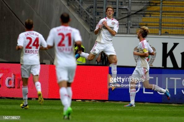 Stefan Kiessling of Leverkusen celebrates with teammates after scoring his team's first goal during the Bundesliga match between Eintracht Frankfurt...