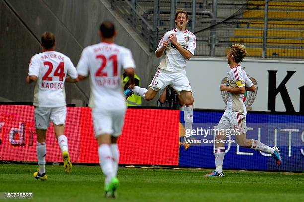 Stefan Kiessling of Leverkusen celebrates with teammates after scoring his team's first goal during the Bundesliga match between Eintracht Frankfurt...