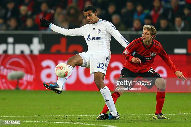 Stefan Kiessling of Leverkusen challenges Joel Matip of Schalke during the Bundesliga match between Bayer 04 Leverkusen and FC Schalke 04 at BayArena...