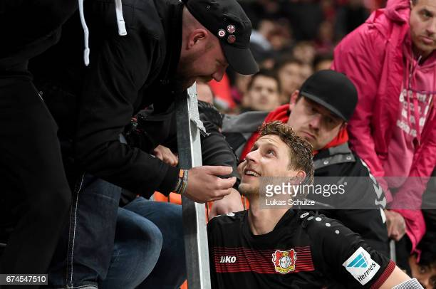 Stefan Kiessling of Leverkusen discuss with the fans after the Bundesliga match between Bayer 04 Leverkusen and FC Schalke 04 at BayArena on April 28...
