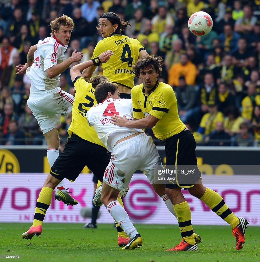 <a gi-track='captionPersonalityLinkClicked' href=/galleries/search?phrase=Stefan+Kiessling&family=editorial&specificpeople=605405 ng-click='$event.stopPropagation()'>Stefan Kiessling</a> of Leverkusen goes up for a header with <a gi-track='captionPersonalityLinkClicked' href=/galleries/search?phrase=Neven+Subotic&family=editorial&specificpeople=2234315 ng-click='$event.stopPropagation()'>Neven Subotic</a> of Dortmund during the Bundesliga match between Borussia Dortmund and Bayer 04 Leverkusen at Signal Iduna Park on September 15, 2012 in Dortmund, Germany.