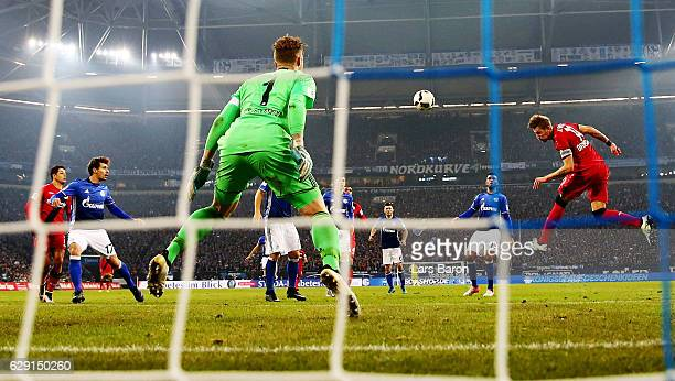 Stefan Kiessling of Leverkusen heads the opening goal during the Bundesliga match between FC Schalke 04 and Bayer 04 Leverkusen at VeltinsArena on...