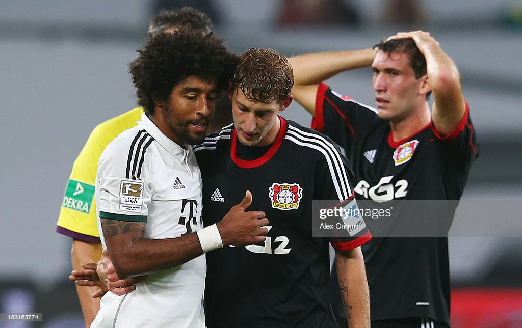 <a gi-track='captionPersonalityLinkClicked' href=/galleries/search?phrase=Stefan+Kiessling&family=editorial&specificpeople=605405 ng-click='$event.stopPropagation()'>Stefan Kiessling</a> (R) of Leverkusen hugs Dante of Muenchen during the Bundesliga match between Bayer Leverkusen and FC Bayern Muenchen at BayArena on October 5, 2013 in Leverkusen, Germany.