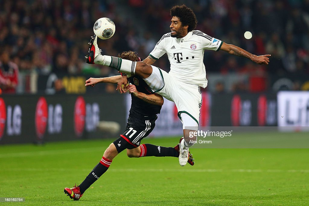 Stefan Kiessling (L) of Leverkusen is challenged by Dante of Muenchen during the Bundesliga match between Bayer Leverkusen and FC Bayern Muenchen at BayArena on October 5, 2013 in Leverkusen, Germany.