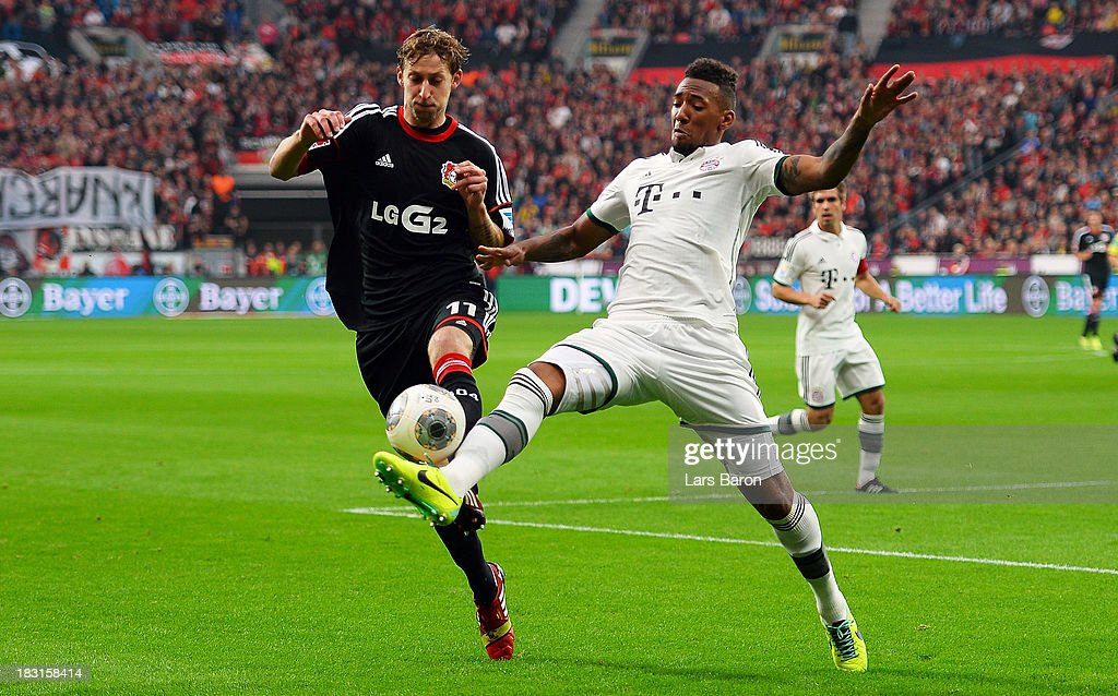 <a gi-track='captionPersonalityLinkClicked' href=/galleries/search?phrase=Stefan+Kiessling&family=editorial&specificpeople=605405 ng-click='$event.stopPropagation()'>Stefan Kiessling</a> of Leverkusen is challenged by <a gi-track='captionPersonalityLinkClicked' href=/galleries/search?phrase=Jerome+Boateng&family=editorial&specificpeople=2192287 ng-click='$event.stopPropagation()'>Jerome Boateng</a> of Muenchen during the Bundesliga match between Bayer Leverkusen and FC Bayern Muenchen at BayArena on October 5, 2013 in Leverkusen, Germany.