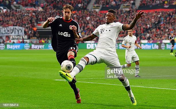 Stefan Kiessling of Leverkusen is challenged by Jerome Boateng of Muenchen during the Bundesliga match between Bayer Leverkusen and FC Bayern...