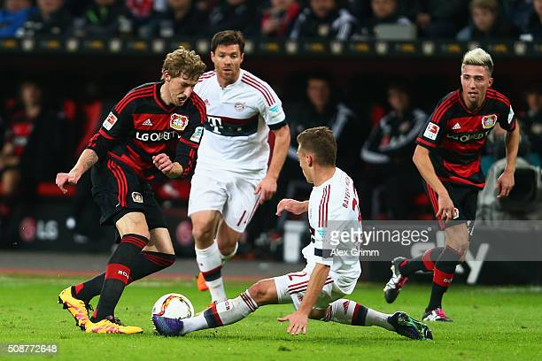 Stefan Kiessling of Leverkusen is challenged by Joshua Kimmich of Muenchen during the Bundesliga match between Bayer Leverkusen and FC Bayern...