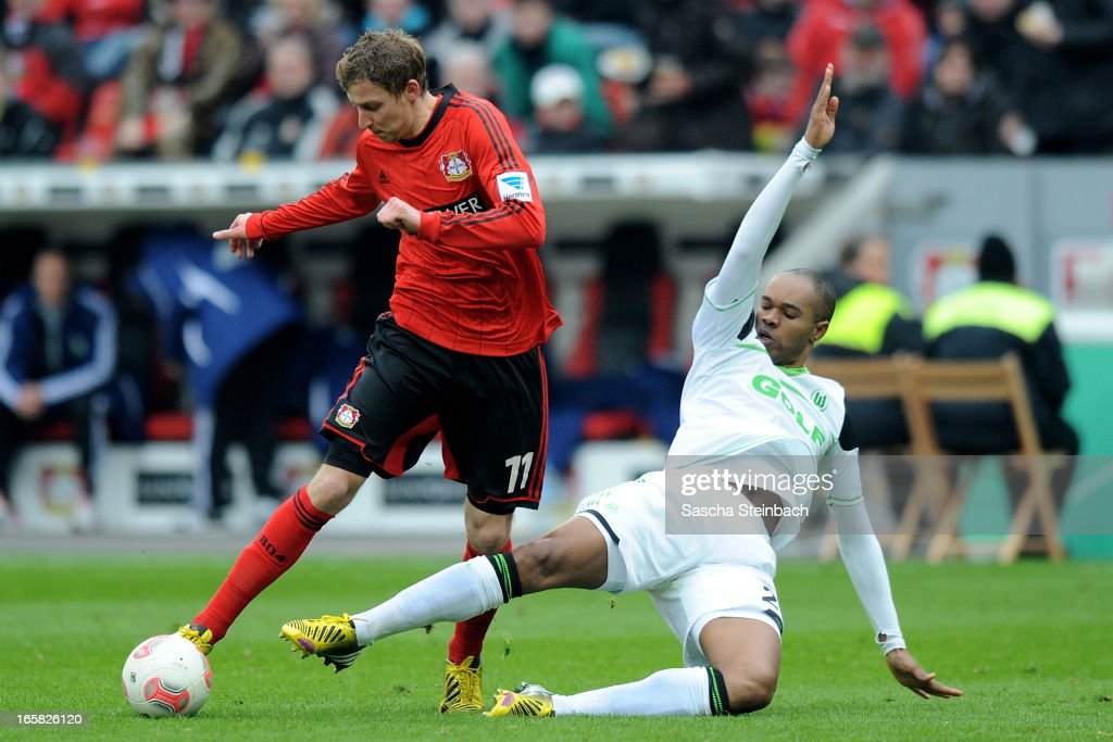 Stefan Kiessling (L) of Leverkusen is tackled by Naldo (R) of Wolfsburg during the Bundesliga match between Bayer 04 Leverkusen and VfL Wolfsburg at BayArena on April 6, 2013 in Leverkusen, Germany.