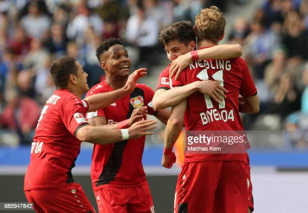 Stefan Kiessling of Leverkusen jubilates with team mates after scoring the fourth goal during the Bundesliga match between Hertha BSC and Bayer 04...