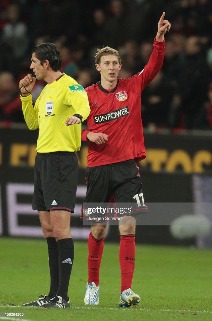 Stefan Kiessling of Leverkusen lifts his arm beside referee Deniz Aytekin after scoring during the Bundesliga match between Bayer Leverkusen and Hamburger SV at BayArena on December 15, 2012 in Leverkusen, Germany.
