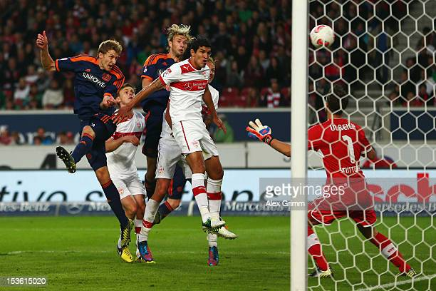 Stefan Kiessling of Leverkusen scores his team's second goal against Maza and goalkeeper Sven Ulreich of Stuttgart during the Bundesliga match...
