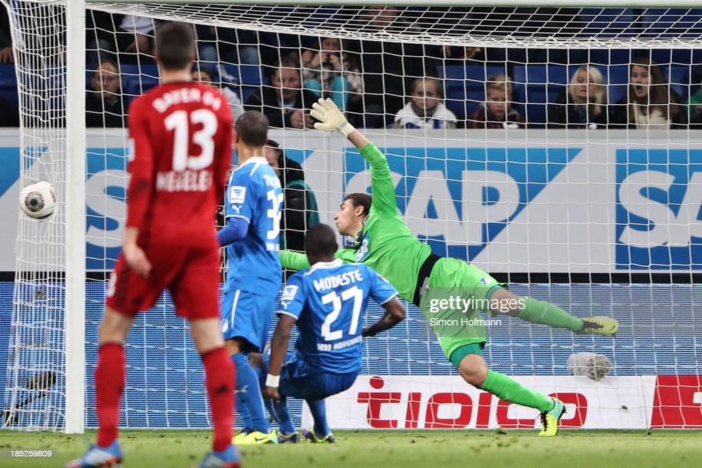 Stefan Kiessling of Leverkusen scores his team's second goal against goalkeeper Koen Casteeln of Hoffenheim during the Bundesliga match between 1899...