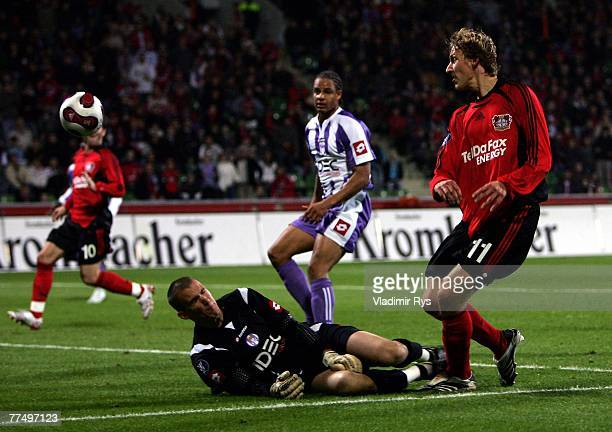 Stefan Kiessling of Leverkusen scores the first goal against Nicolas Douchez of Toulouse during the UEFA Cup Group E match between Bayer Leverkusen...