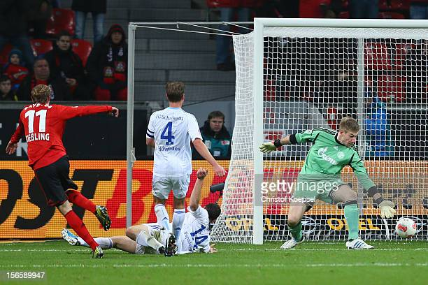 Stefan Kiessling of Leverkusen scores the second goal against Kyriakos Papadopoulos Benedikt Hoewedes and Lars Unnerstall of Schalke during the...