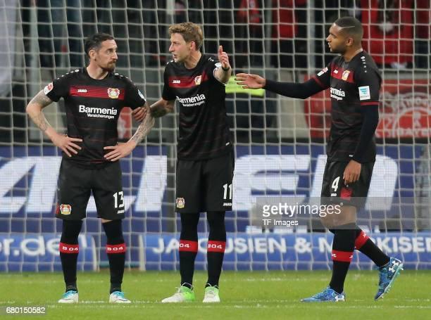 Stefan Kiessling of Leverkusen speak with Roberto Hilbert of Leverkusen and Jonathan Tah during to the Bundesliga match between Bayer 04 Leverkusen...