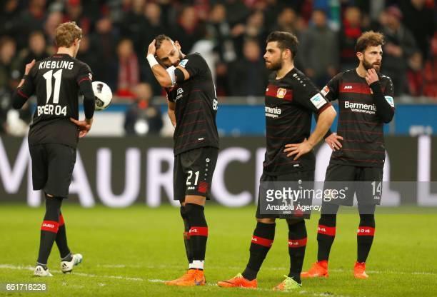 Stefan Kiessling Omer Toprak Kevin Volland and Admir Mehmedi of Leverkusen react after the Bundesliga soccer match between Bayer Leverkusen and...