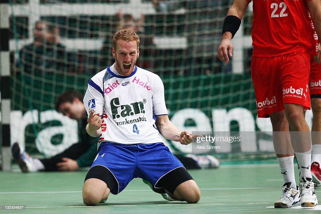 Stefan Kneer of Grosswallstadt celebrates after scoring the equalizing goal in the last second of the Toyota Handball Bundesliga match between T VGrosswallstadt and MT Melsungen at f.a.n. frankenstolz arena on November 11, 2011 in Aschaffenburg, Germany.