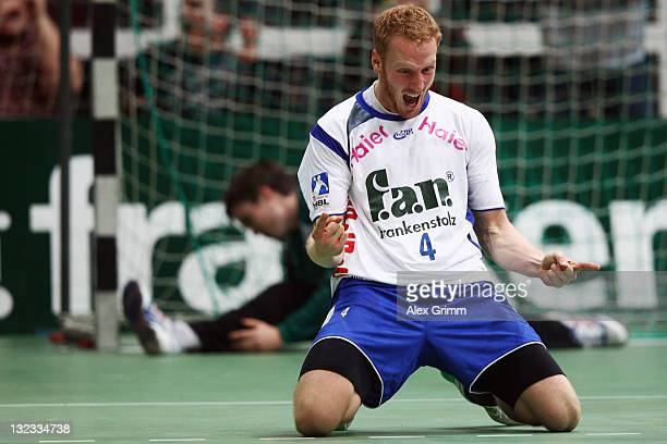 Stefan Kneer of Grosswallstadt celebrates after scoring the equalizing goal in the last second of the Toyota Handball Bundesliga match between T...