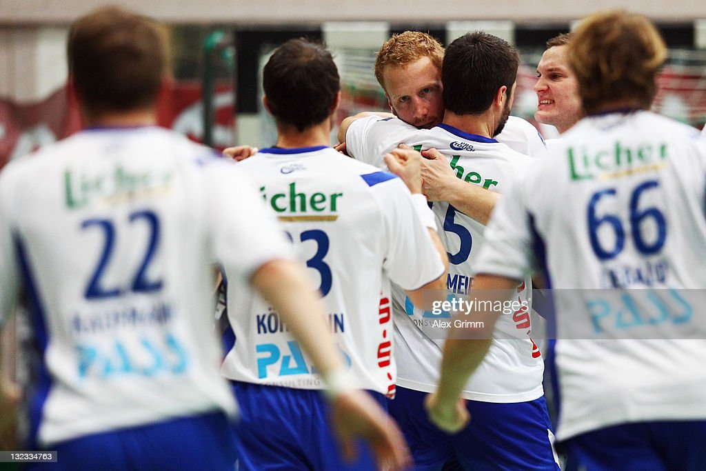Stefan Kneer (C) of Grosswallstadt celebrates with team mates after scoring the equalizing goal in the last second of the Toyota Handball Bundesliga match between T VGrosswallstadt and MT Melsungen at f.a.n. frankenstolz arena on November 11, 2011 in Aschaffenburg, Germany.