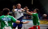 Stefan Kneer of Grosswallstadt is challenged by Bennet Wiegert and Bartosz Jurecki of Magdeburg during the Toyota Handball Bundesliga match between...