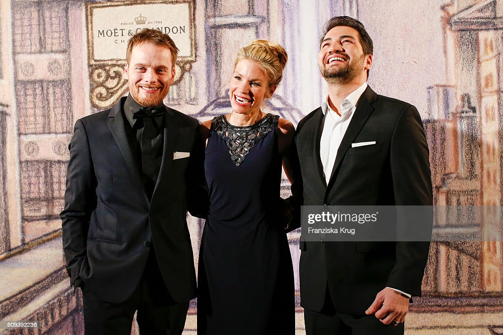 Stefan Konarske, Nina-Friederike Gnaedig and Buelent Sharif attend the Moet & Chandon Grand Scores 2016 at Hotel De Rome on February 6, 2016 in Berlin, Germany.