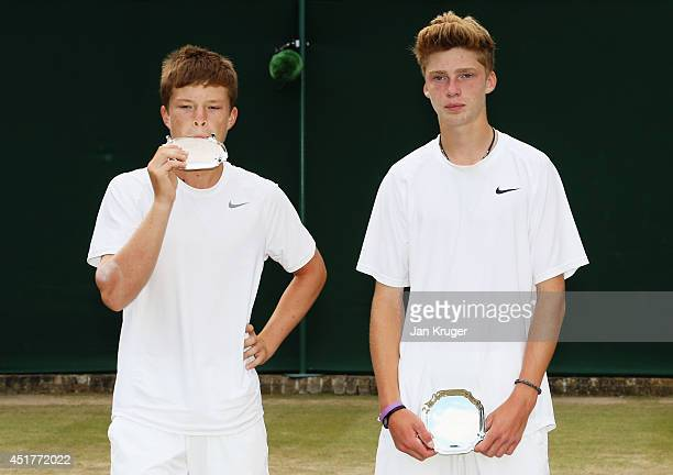 Stefan Kozlov of the United States and Andrey Rublev of Russia stand dejected after losing the Boys' Doubles Final match against Marcelo Zormann and...