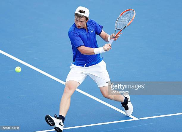 Stefan Kozlov of the United States hits a return to Damir Dzumhur of Bosnia and Herzegovina during their qualifying match on Day 2 of the Western...