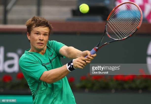Stefan Kozlov of the United States plays a backhand against Donald Young of the United States in their first round match during day five of the BNP...