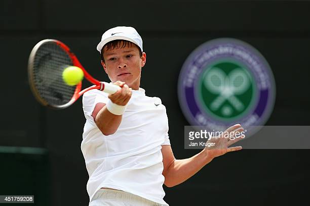 Stefan Kozlov of the United States plays a forehand return during the Boys' Singles Final match against Noah Rubin of the United States on day...