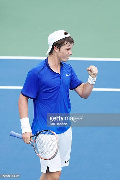 Stefan Kozlov of the United States reacts after winning a point against Damir Dzumhur of Bosnia and Herzegovina during their qualifying match on Day...