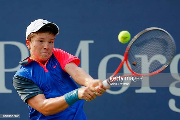 Stefan Kozlov of the United States returns a shot against Borna Coric of Croatia during their Men's Qualifying Singles round two match prior to the...