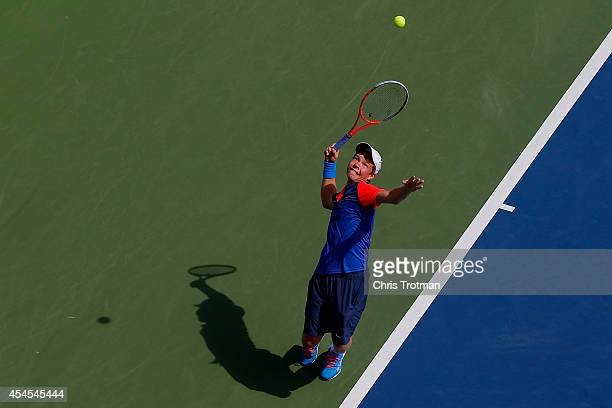 Stefan Kozlov of the United States serves against Rafael Matos of Brazil during their junior boys' singles second round match on Day Ten of the 2014...